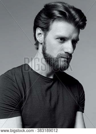 Close-up Portrait Of A Brutal Bearded Man Black And White