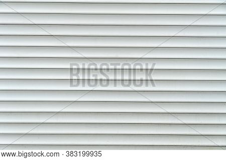 Background Of Gray-white Horizontal Metal Bands. Roll-up Curtains And Garage Doors. Protecting Windo