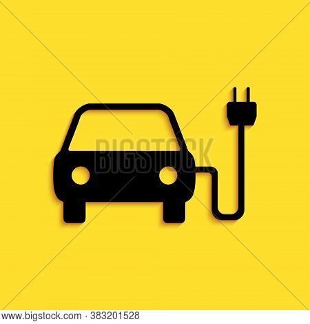 Black Electric Car And Electrical Cable Plug Charging Icon Isolated On Yellow Background. Electric C