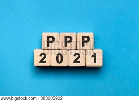 Ppp - Text Concept On Wooden Cubes With Gradient Blue Background