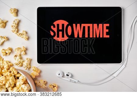 Showtime Logo On The Screen Of The Tablet Laying On The White Table And Sprinkled Popcorn On It. App