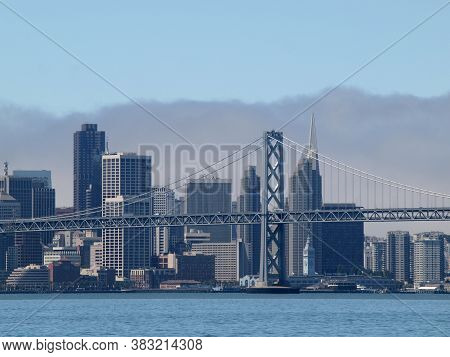 San Francisco -  August 16, 2010: Bay Bridge And Skyline With Ferry Building, Downtown And Pyramid D