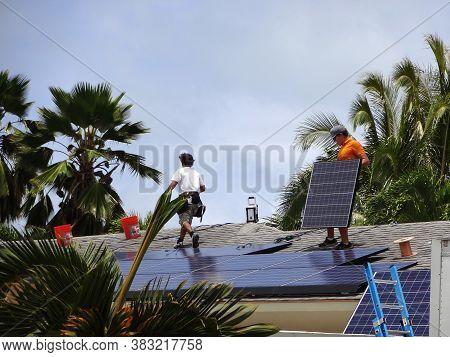 Honolulu - August 29, 2012: Workers Install Solar Panels Array On Roof Of House In Honolulu, Hawaii.