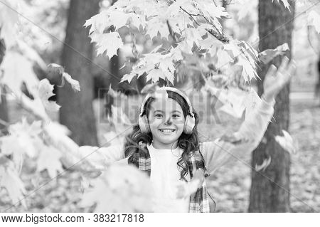 Melody Of Autumn. Schoolgirl Listening Modern Headphones. Headphones Technology. Falling Leaves. Hap