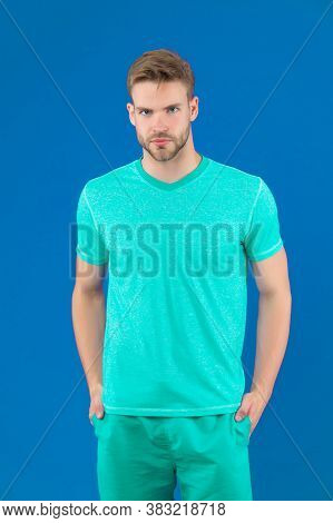 Man In Tshirt And Shorts On Violet Background. Guy In Blue Casual Clothes. Macho In Active Wear For