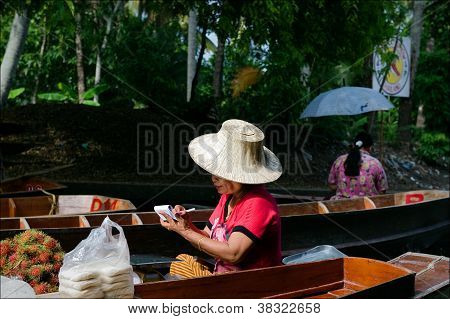 The Seller By A Boat.
