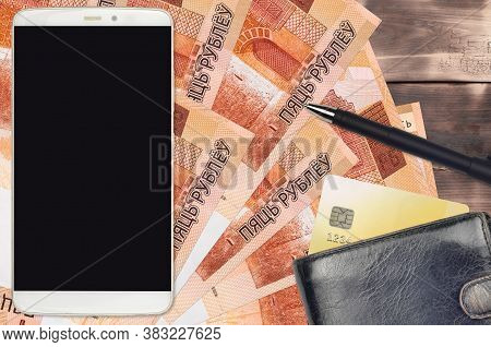 5 Belorussian Rubles Bills And Smartphone With Purse And Credit Card. E-payments Or E-commerce Conce