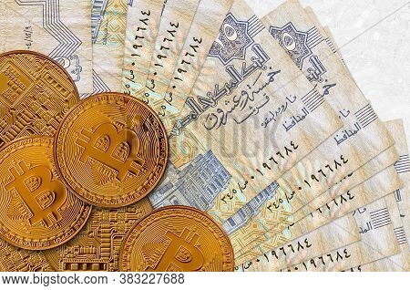 25 Egyptian Piastres Bills And Golden Bitcoins. Cryptocurrency Investment Concept. Crypto Mining Or