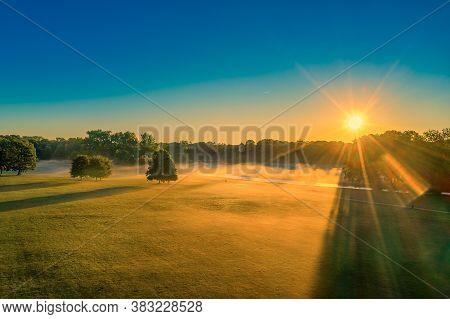 Wonderful Foggy Morning In Munichs Englisher Garten, While The Sunrise Is Ongoing, Golden Light Scen