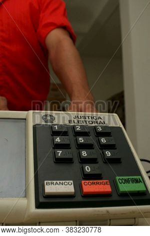 Eunapolis, Bahia / Brazil - September 29, 2008: Employee Of The Regional Electoral Court Repairs A B