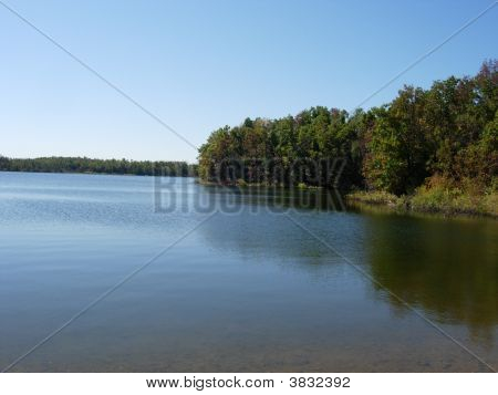 very relaxing and beautiful view of lake in the month of October poster