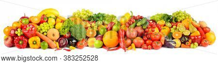Wide panoramic composition of ripe fruits, berries and vegetables isolated on white background.