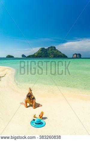 Woman on the Thai beach of Poda island in Krabi Thailand