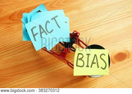 Scales With The Words Bias And Facts.