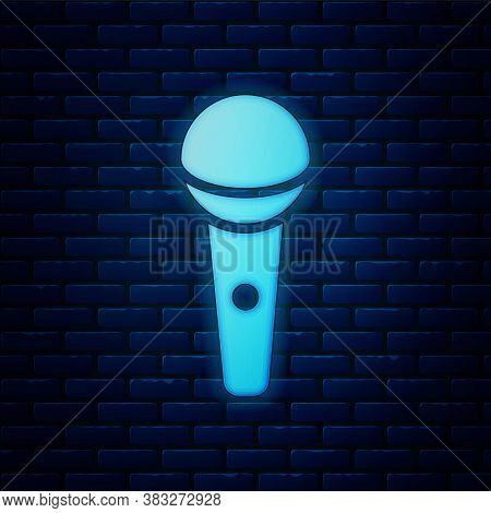Glowing Neon Microphone Icon Isolated On Brick Wall Background. On Air Radio Mic Microphone. Speaker