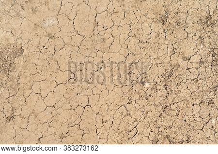 Dry Ground Rough Cracks In The Land With Sand In Desert. Serious Water Shortages And Drought Barren