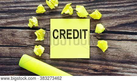 Credit . Notes About Pay , Concept On Yellow Stickers On Wooden Background