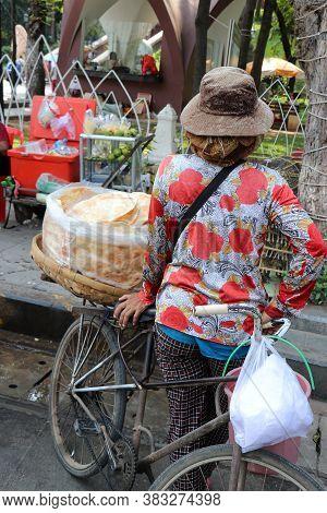 Phnom Penh, Cambodia, Feb 4, 2019 : Backside Of Kite Cracker Seller, Kite Cracker In The Clear Plast