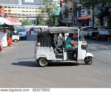 Phnom Penh, Cambodia, Jan 30, 2019 : Tuk Tuk Or Taxi Tricycle On The Road, Lifestyle Of Traffic In P