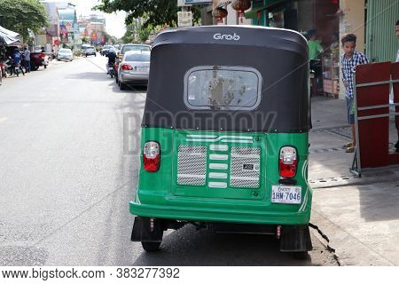 Phnom Penh, Cambodia, August 17, 2019 : Tuk Tuk Or Taxi Tricycle In Green Color On The Road, Lifesty