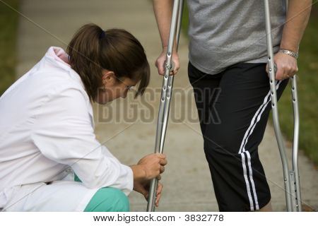Physical Therapist Adjusts Crutches
