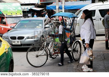 Nonthaburi, Thailand - 29 May, 2020 : The Man And Tricycle Hire With Wear Hygienic Masked To Prevent