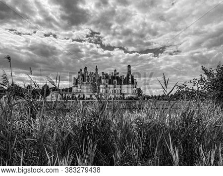 Dramatic black and white view of Chateau de Chambord in the Loire Valley, UNESCO world heritage in France