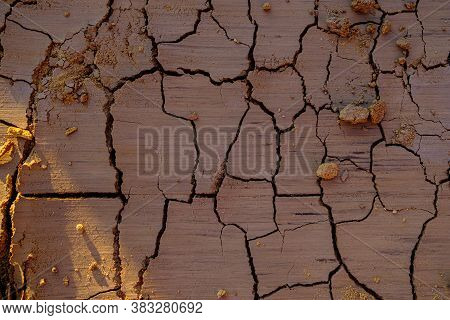 An Overhead View Of A Natural Mosaic Formed By Cracks In Dry Clay Soil. Dead Nature. Drought. Backgr