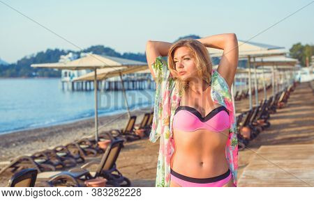 Beauty Of New Age. Natural Pretty Young Woman In Swimsuit Near The Sea. Size Plus And Xl Women. Swim