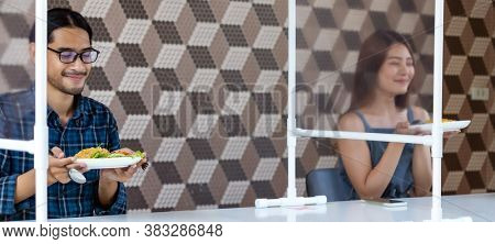 Panoramic two asian influencer food blogger or vlog show food at new normal social distance restaurant with table shiled partition. Restaurant new normal lifestyle and food influencer concept.