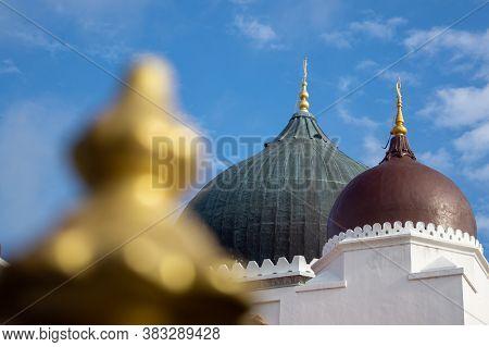 Dome Of Masjid Kapitan Keling In Blue Sky..