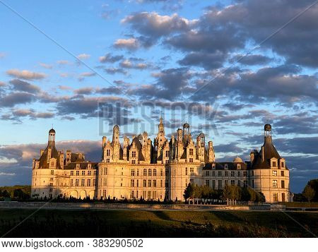 Beautiful sunset over the Chateau de Chambord in the Loire Valley, UNESCO world heritage in France