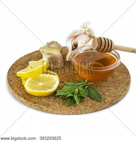Home Treatment Kit For Flu And Seasonal Colds. Lemon, Mint, Honey, Ginger And Garlic On Wooden Tray