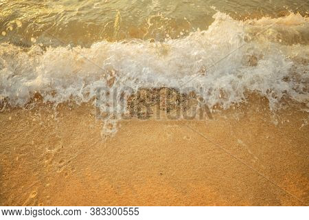 Scenic Seascape. Splashing Waves At Sandy Beach. Sunset Time. Waterscape For Background. Selected So