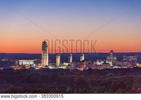 Albany, New York, USA city skyline at dusk in early autumn.