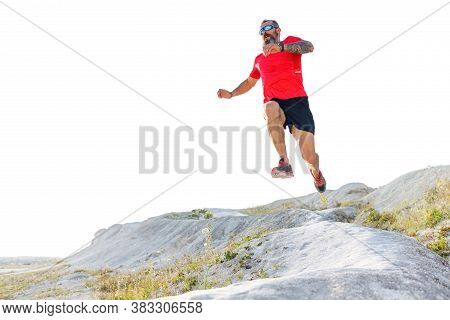 Bearded Man Jump From Hill On Trail Running Cross