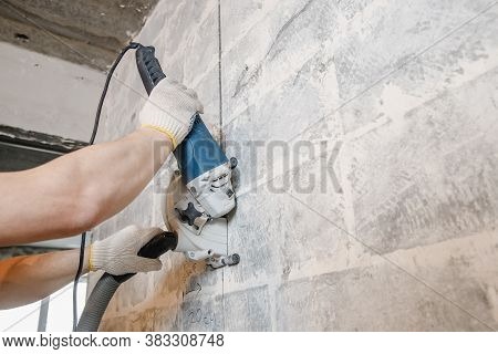 Builder Man Cutting Electrical Chase In Concrete Wall With Circulation Saw Drill Diamond Crown