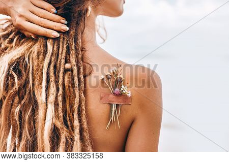 Beautiful Young Woman On The Beach. Over The Shoulder Medium Close Up Shot