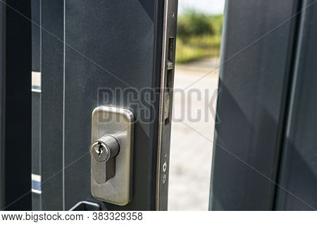 Closed Wicket In A Modern Panel Fence In Anthracite Color, Visible Letterbox And Latch.