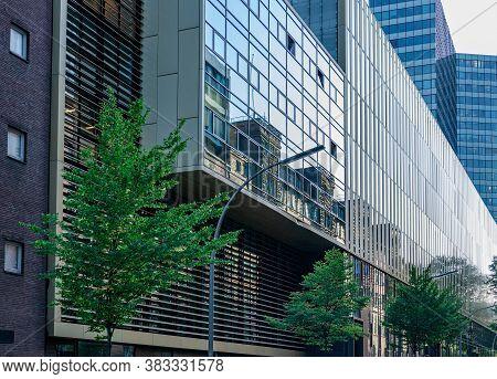Hamburg / Germany - 09 06 2018: Mirrored Glass Wall Of Modern Corporate Building In Hamburg Germany.