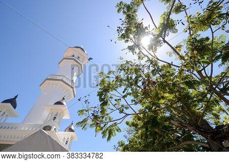 Georgetown, Penang/malaysia - Jul 30 2016: Masjid Kapitan Keling With Green Tree In Hot Sunny Day.