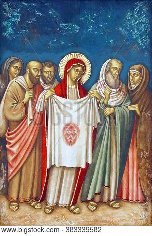 ZAGREB, CROATIA - FEBRUARY 19, 2013: 6th Stations of the Cross, Veronica wipes the face of Jesus, parish church Precious Blood of Jesus in Zagreb, Croatia