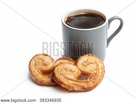 Flaky  Pastry Hearts Glazed With Caramelized Sugar And Cup Of Coffee Isolated On White