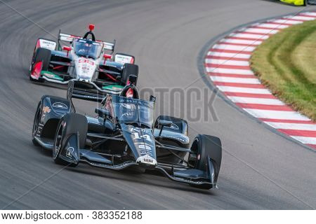 August 30, 2020 - Madison, Illinois, USA: TONY KANAAN (14) of Salvador, Brazil  races through the turns during the  race for the Bommarito Automotive Group 500 at World Wide Technology Raceway