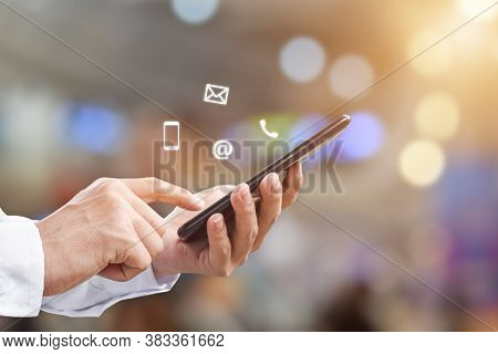 Close-up Image Of Man Hands Using Mobile Smartphone With ( Mail, Phone, Email ) Icon. Contact Us Con