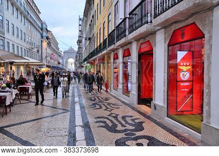 Lisbon, Portugal - June 5, 2018: People Visit Rua Augusta Shopping Street In The Evening In Lisbon.