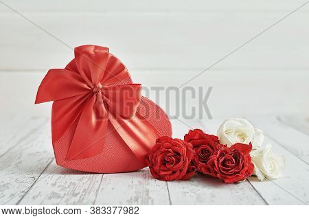 Valentine Day Romantic Background With Red Roses And Gift Box. Happy Valentine's Day Greeting Card.