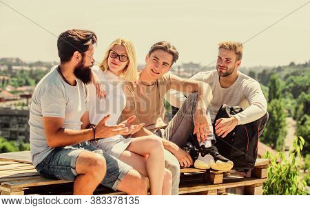 Men And Woman Talking Nature Background. Spending Time With Friends. Discussing Ideas. Summer Vacati