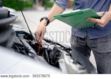 Auto Mechanic Checking The Oil Level In Car Engine, Check And Maintenance The Oil Level In Car.
