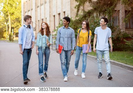 Five Multiracial High-school Students Walking And Talking In University Campus Outdoors. College Edu